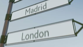 Madrid direction sign on road signpost with European cities captions. 4K conceptual clip. Madrid direction sign on road signpost with European cities captions stock video