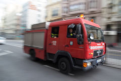 Madrid Fire Truck. MADRID, SPAIN - OCTOBER 10, 2014: A fire truck speeding through the streets of Madrid. Due to Spanish law, only police use blue lights and Stock Photos