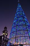 Madrid - Illuminated Christmas Tree at night 2017, Puerta del Sol square and Clock Tower in background. Stock Photography