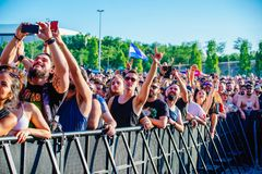 The audience in a concert at Download heavy metal music festival. MADRID - JUN 22: The audience in a concert at Download heavy metal music festival on June 22 stock photo