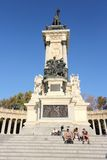 Madrid landmark. MADRID, SPAIN - OCTOBER 23, 2012: People visit Monument to Alfonso XII in Madrid. The royal memorial located in Buen Retiro Park was designed by Stock Photography