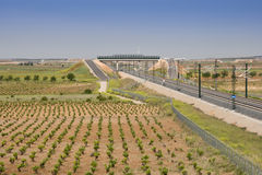 Madrid-Levante High-speed rail. View of a High-speed rail stretch trough agrarian landscape in Toledo (Spain royalty free stock photos