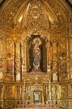 Madrid - Madonna ed altare barrocco di Capilla del Sanctisimo dalla chiesa San Isidoro Fotografie Stock Libere da Diritti
