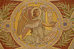 Madrid - Mosaic of angel as symbol of Saint Matthew the Evangelist. In Iglesia de San Manuel y San Benito by architect Fernando Arbos from 19. cent. in March 9 Royalty Free Stock Photo