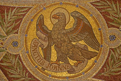 Madrid - Mosaic of eagle as symbol of Saint John the Evangelist. In Iglesia de San Manuel y San Benito by architect Fernando Arbos from 19. cent. in March 9 Royalty Free Stock Images