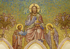 Madrid - Mosaic of Jesus Christ and apostle Peter and John from main apse of  Iglesia de San Manuel y San Benito Royalty Free Stock Photos