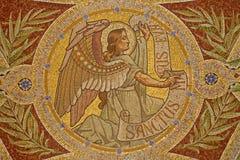 Madrid - mosaik av ängeln som symbol av St Matthew evangelisten Royaltyfri Foto