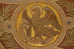 Madrid - mosaik av örnen som symbol av St John evangelisten Royaltyfria Bilder