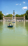 MADRID, NOVEMBER 22: People enjoy their free time at The Buen Re. Tiro Park lake in Madrid, Spain on November 22, 2014 stock images