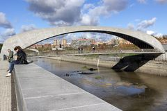 Madrid, Puente de Matadero on Manzanares River. Madrid Rio is A green area for sports and leisure. Madrid, Spain - November 23, 2018: people near the bridge stock photography