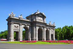 Madrid Puerta de Alcala with flower gardens Royalty Free Stock Images