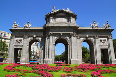 Madrid Puerta de Alcala with flower gardens Royalty Free Stock Image