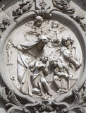 Madrid - Relief from main portal of Basilica di San Miguel Stock Images