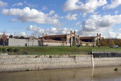 Madrid - Madrid Rio park area for sports and leisure on Manzanares River. In the background Matadero Madrid cultural center. Madrid Rio a green area for sports royalty free stock image