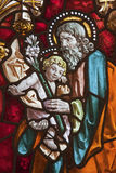Madrid - Saint Joseph from windowpane of church San Jeronimo el Real Stock Photography