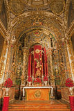 Madrid - Side altar and statue of Santisimo Cristo de la buena muerte from church San Isidoro Stock Photos