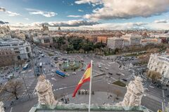 Free Madrid Skyline Cloudy Sunset View From Cibeles Palace Townhall, Big Spanish Flag Madrid City Council Building Royalty Free Stock Images - 185375119