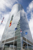 Madrid - skyskrapa Torre Espacio och flaggor Arkivfoto