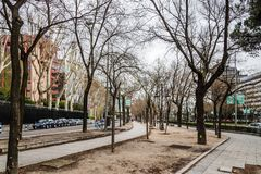 Castellana Avenue Boulevard in Madrid. Madrid, Spain - April 7, 2018:  Castellana Avenue Boulevard in Madrid a cloudy day Royalty Free Stock Images