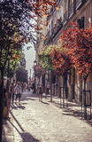 MADRID, SPAIN - APRIL 26: Old narrow street with few cafe in Apr Stock Images