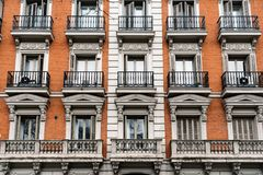 Old residential building in Madrid. Madrid, Spain - April 7, 2018:  Old residential building in Castellana Avenue in Madrid Royalty Free Stock Image