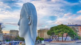 View Julia statute by Jaume Plensa. MADRID, SPAIN - APRIL 2: View Julia statute by Jaume Plensa at sunset HDR effect on April 2, 2019 in Madrid, Spain royalty free stock photos