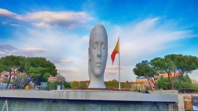 View Julia statute by Jaume Plensa. MADRID, SPAIN - APRIL 2: View Julia statute by Jaume Plensa at sunset HDR effect on April 2, 2019 in Madrid, Spain stock photo