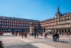 MADRID, SPAIN - ARRIL 12, 2019: Felipe III statue and Casa de la Panaderia on Plaza Mayor in Madrid - a central square in the city. The bronze statue of King stock photo