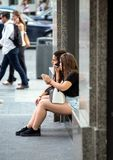 2017.01.06, Madrid, Spain. Beautiful young women sitting on the street. People of Madrid. stock photo