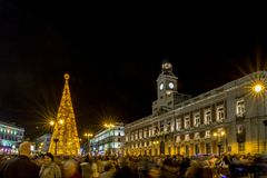 Madrid, Spain; December 2015: Christmas tree with lights glowing and Christmas decoration in the Puerta del Sol, of the city. Madrid , Spain stock photography