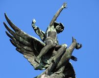 Detail of the sculpture of the Phoenix Bird in Madrid, Spain. Madrid, Spain - December 6, 2016: Detail of the sculpture of the Phoenix Bird by Mariano Benlliure royalty free stock photography