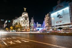 Gran Via Street in Madrid at night on Christmas time with lighti. Madrid, Spain - December 8, 2017: Gran Via and Alcala streets in Madrid at night on Christmas Royalty Free Stock Image