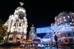 Gran Via Street in Madrid at night on Christmas time with lighti. Madrid, Spain - December 8, 2017: Gran Via Street in Madrid at night on Christmas time. Long Stock Image