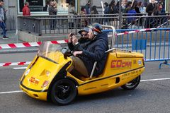 Madrid, Spain - December 3, 2016: Tourists in a GoCar vehicle. GoCar is a rental 2-seater, 3-wheeled talking GPS-guided tour car for tourists stock images