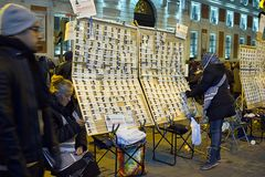 A woman sells Christmas Lottery tickets Dona Manolita at night in Puerta del Sol, Madrid Stock Images