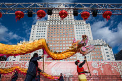 02/21/2015, Madrid, Spain. Dragon dance in the Chinese New Year. 02/21/2015, Madrid, Spain. Dragon dance, dancers on stage dancing traditional dance in the Stock Photo