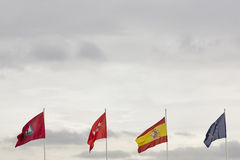 Madrid Spain Europe flags over a cloudy sky. Royalty Free Stock Photo