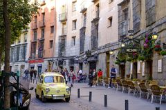 Seat 600 circulates on the old street of Madrid. Stock Photos
