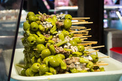 MADRID, SPAIN - FEBRUARY 12, 2017: Spanish traditional snacks with olives at San Miguel Market. At Madrid, Spain Royalty Free Stock Image