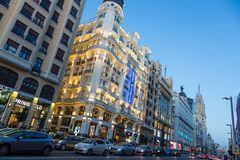 Madrid, Spain. Gran Via, main shopping street at dusk. stock images