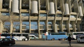 Outside view of Santiago Bernabeu Stadium with transport parked nearby, Madrid. MADRID, SPAIN - JANUARY 17, 2018: Cars and buses parked near Santiago Bernabeu stock footage