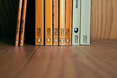 Madrid, Spain, January 11 2020: Collection of vintage Penguin books on wooden shelf.