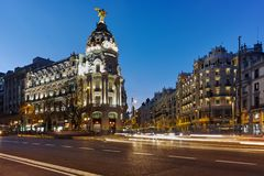 MADRID, SPAIN - JANUARY 23, 2018: Sunset view of Gran Via and Metropolis Building in City of Madrid. Spain royalty free stock photo