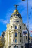 Metropolis building, in Madrid. MADRID, SPAIN - JANUARY 1, 2018: View of Alcala street, with the Metropolis building, locals and visitors, in Madrid, Spain royalty free stock photography