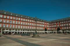 People on the Plaza Mayor with old large building in Madrid stock image