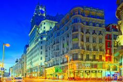 Gran Via Street in Madrid, after sunset, traffic lights on Gran. Madrid, Spain - June 04, 2017 : Gran Via Street in Madrid, after sunset, traffic lights on Gran Royalty Free Stock Images