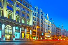 Gran Via Street in Madrid, after sunset, traffic lights on Gran. Madrid, Spain - June 04, 2017 : Gran Via Street in Madrid, after sunset, traffic lights on Gran Royalty Free Stock Photo