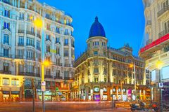 Gran Via Street in Madrid, after sunset, traffic lights on Gran. Madrid, Spain - June 04, 2017 : Gran Via Street in Madrid, after sunset, traffic lights on Gran Stock Photo