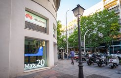 Madrid, Spain. June 2019: Huawei Experience Center in Salamanca district. Madrid, Spain. June 2019: People walking in front of Huawei store and customer service royalty free stock photos