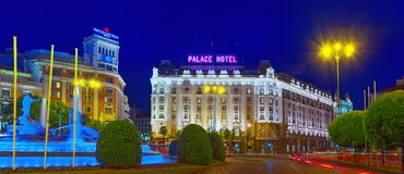 Neptune Fountain Fuente de Neptuno and The Westin Palace Hotel. Madrid, Spain - June 05, 2017 : Neptune Fountain Fuente de Neptuno and The Westin Palace Hotel on Royalty Free Stock Photo